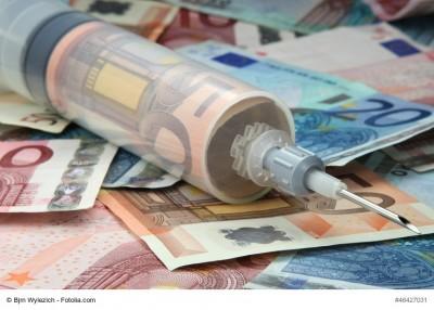 Geldspritze auf Geldscheinen