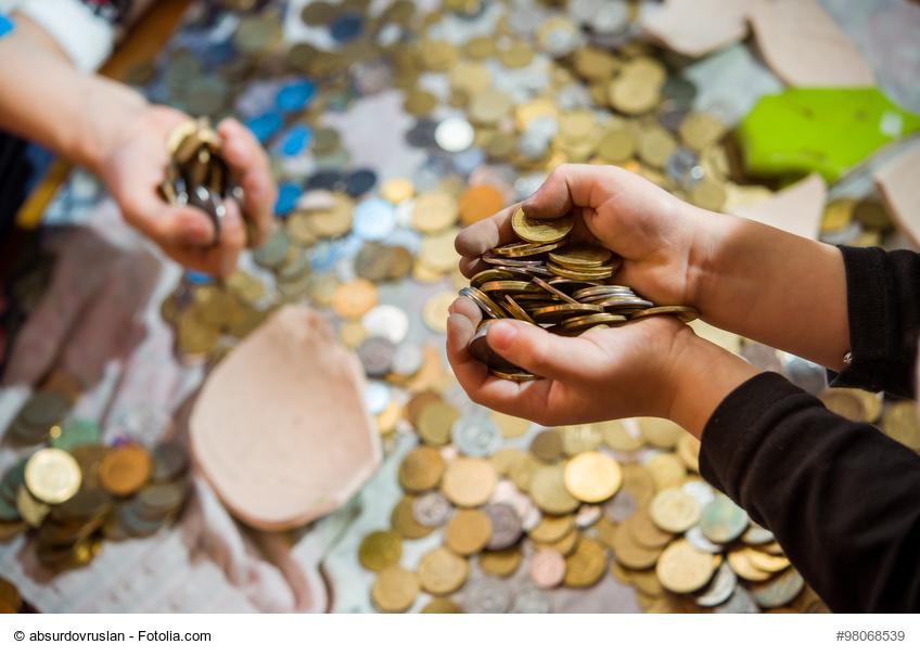 children see the coin treasure of a broken piggy bank