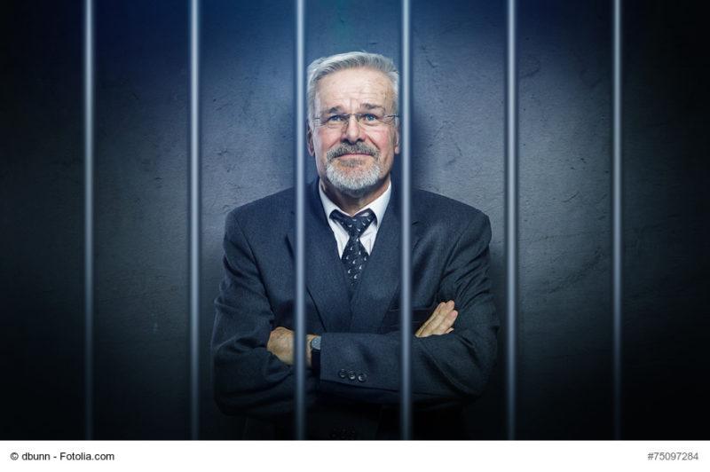 Geschäftsmann im Gefängnis