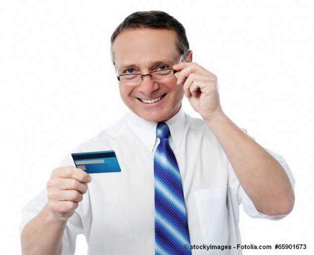 Businessman holding credit card