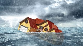sinking house in the sea