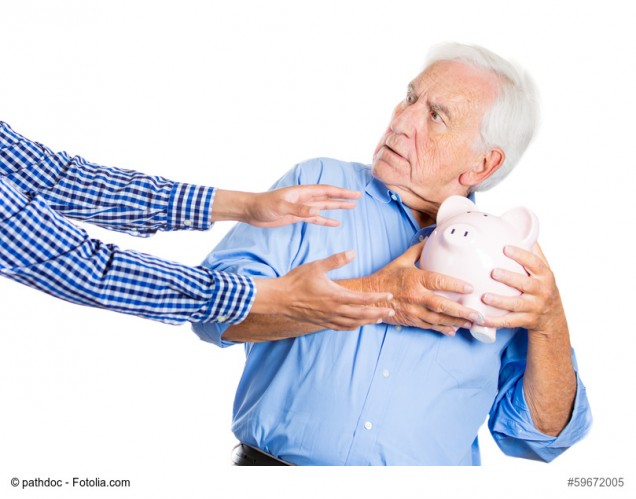 Senior man protecting piggy bank, savings from being stolen