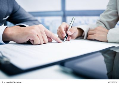 Female hand signing contract