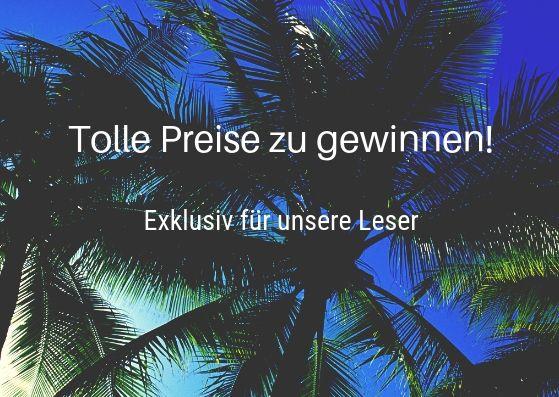 Palmen vor blauem Himmel mit der Aufschrift: Tolle Preise zu gewinnen!Gewinnspiel.1
