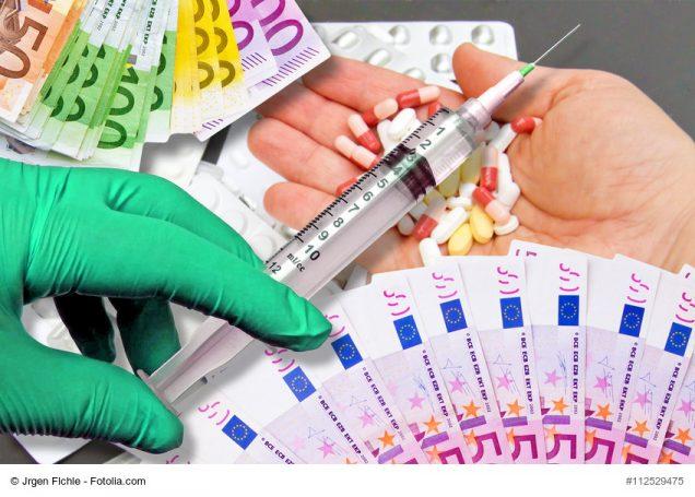 Geldscheine, Spritze und Medikamente