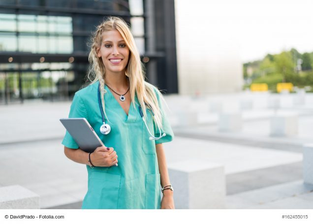 Female doctor, nurse or vet outdoors smiling looking at the camera isolated portrait closeup.