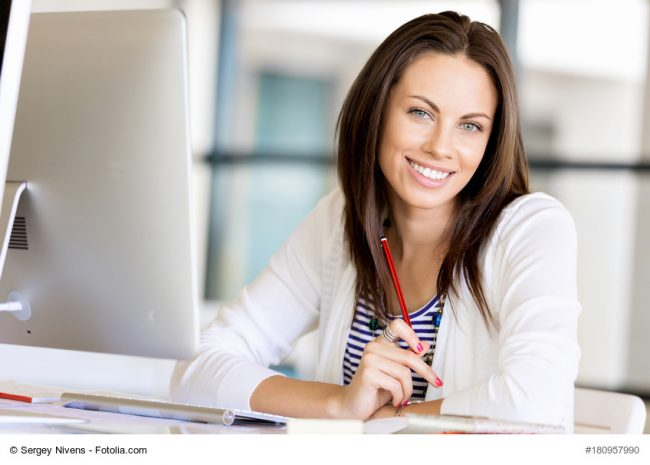 Happy entrepreneur or freelancer in casual wear in an office or home
