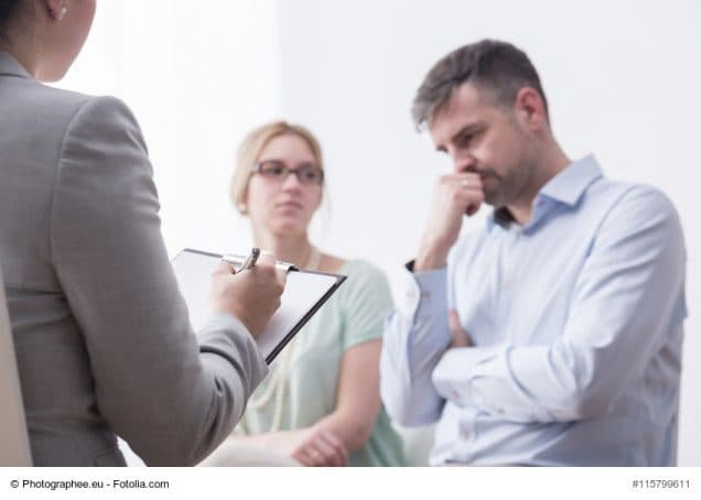 Shot of a female therapist taking notes during the meeting with a young marriage
