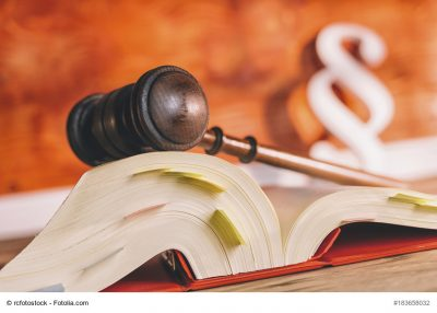 law book with gavel and paragraph symbol in court office - law concept image