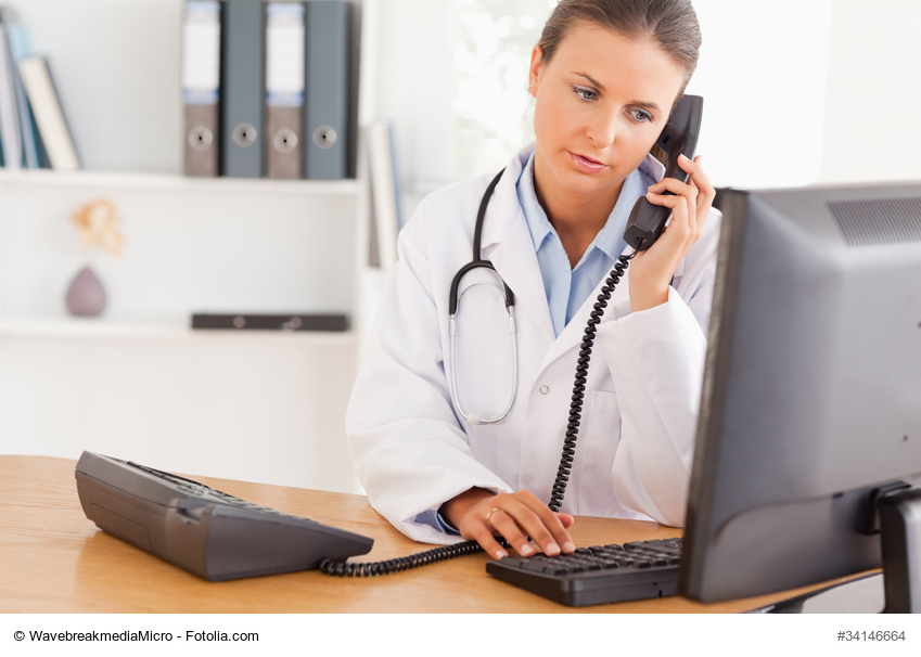 Serious doctor on the phone