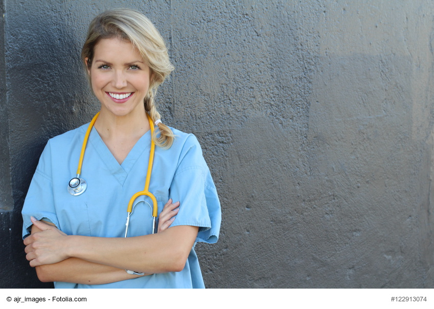 Young beautiful successful female doctor with stethoscope - portrait with copy space