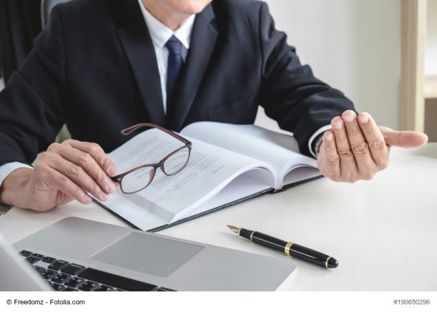 Image of Male lawyer or judge importune bribes client, working with Law books, report the case on table in modern office, Law and justice concept.