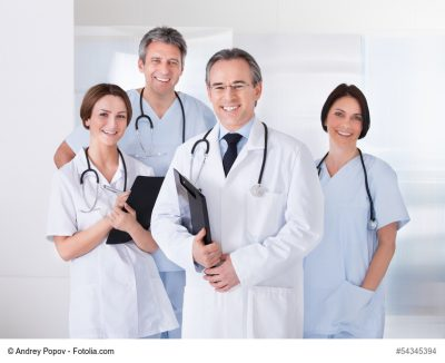 Male Doctor In Front Of Team