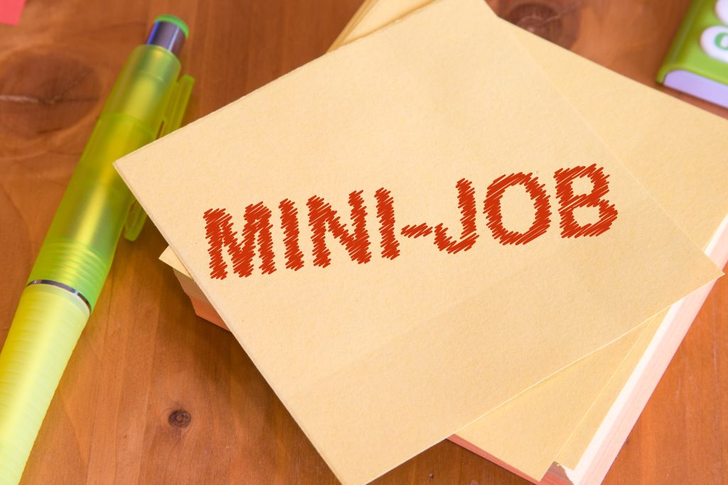 Zettel mit der Aufschrift Minijob
