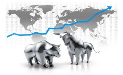 Bulle und Bär vor einer Weltkarte mit Aktienkurs
