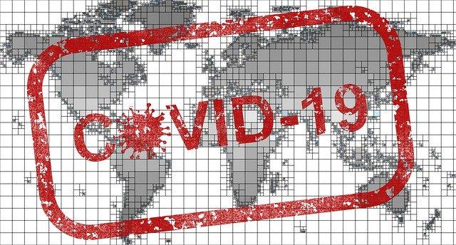 covid-19- Stempel auf einer Weltkarte