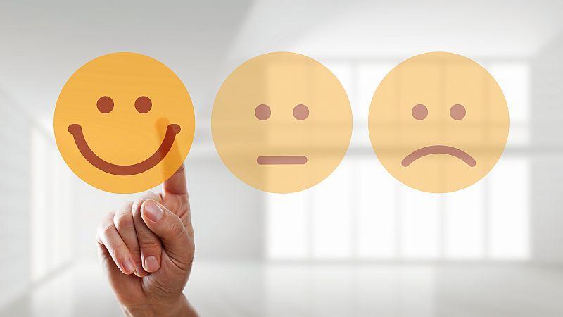 ein lachender Smiley, ein neutrale Smiley und ein trauriger Smiley