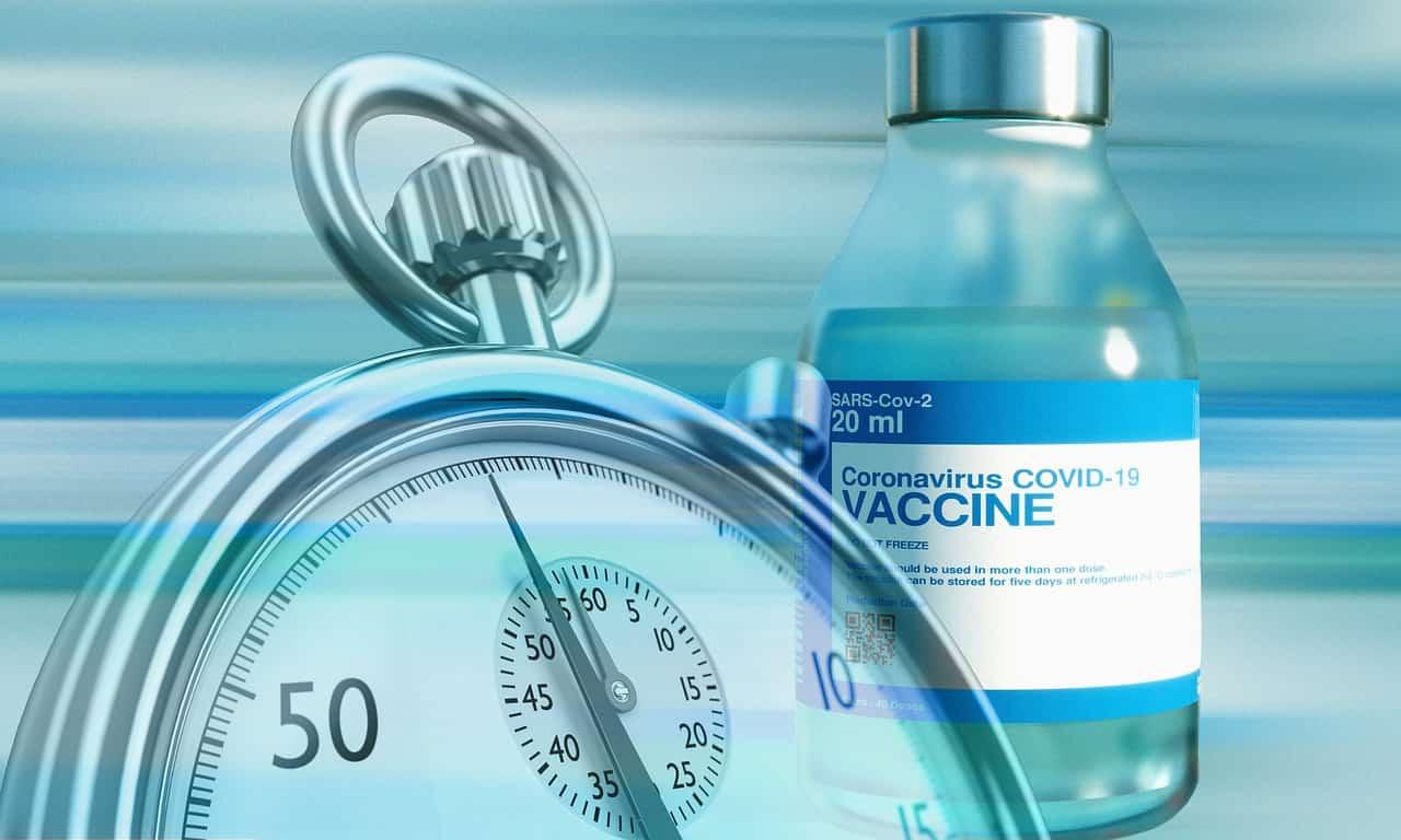 Impfstoff und Stoppuhr